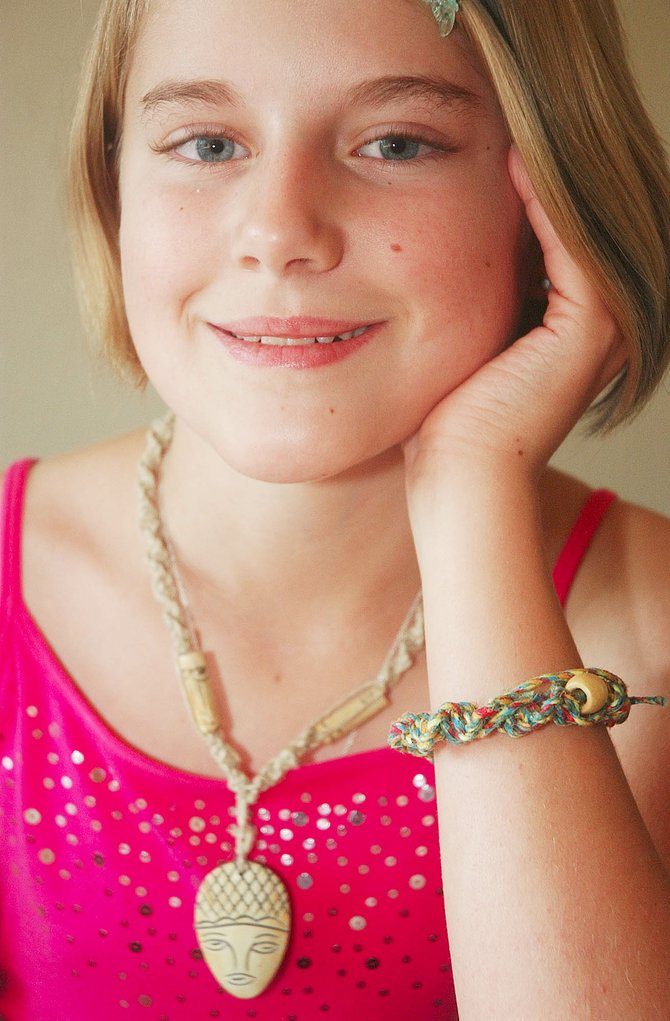 Cassie Wilhelm, 11, of Steamboat Springs, will sell her handmade jewelry Saturday at the Farmers Market on Sixth Street.