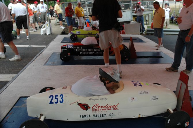 Morgan Mertz, 14, of Steamboat Springs, checks her vehicle at the All-American Soap Box Derby championship July 26 in Akron, Ohio. Morgan finished in 19th place at the event.