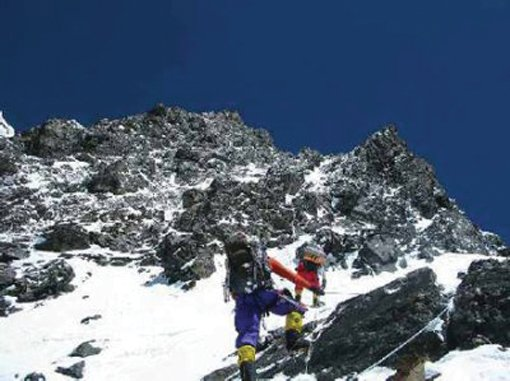 Eric Meyer (in red) and Fredrik Strang climb toward camp 3 during the bid for the summit on K2. The pair reached 8100 meters but elected to turn back the same day 11 other climbers died on K2.