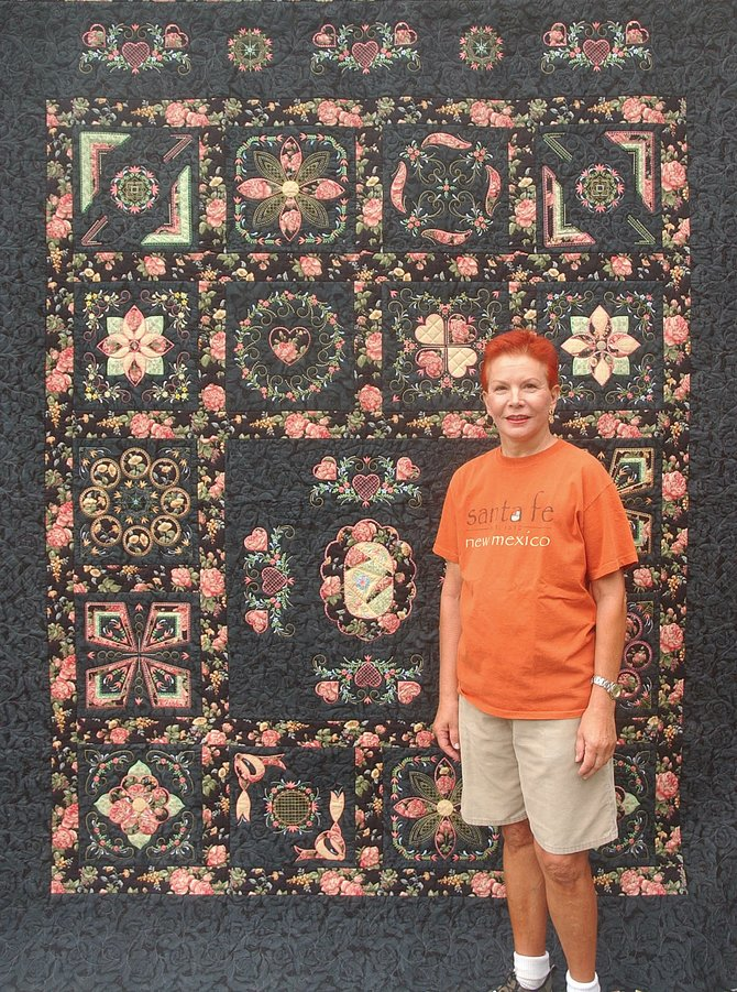 Grimaldi stands in front of a quilt she is entering in this year's Routt County Fair.