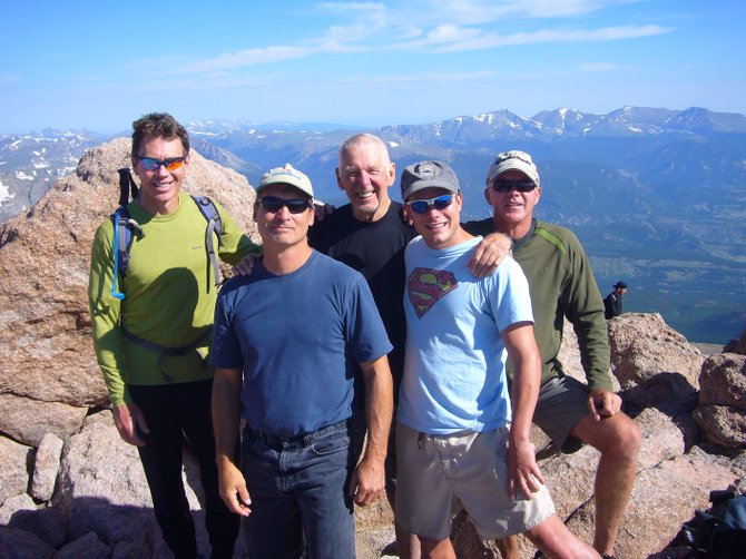 From left, Cam Boyd, Greg Forney, Bill Spinder, Eric Gautreaux and Tim Dooley stand on the summit of Long's Peak last month, on Spinder's 75th birthday.