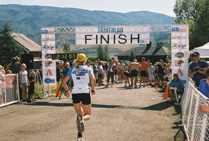 Joy Rasmussen runs toward the finish line during a past Steamboat Springs Triathlon. Rasmussen and other organizers of this year's event host a preparation meeting at 7 p.m. today at the downtown offices of Colorado Group Realty, at 751 Yampa St.