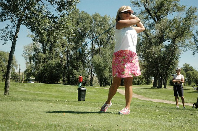 Brenda Johnson tees off Wednesday during the ninth annual Rally for the Cure breast cancer benefit golf event at the Yampa Valley Golf Course. Johnson's foursome - including Mary Nelson, Patty Bruchez and Christy Rolando - scored a 71 in the best ball scramble format and was the overall champion of the tournament.