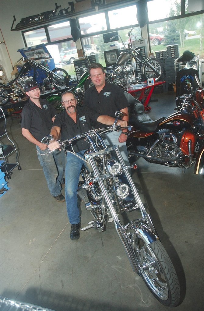 A chopper shop has opened on Loggers Lane on the west side of Steamboat Springs. Insta-Gator Choppers is owned by Scott Singer, who sits on his nickel-plated bike. Also pictured is chopper builder Paul Worster, left, and Mike Wilson, who is helping Singer with marketing.
