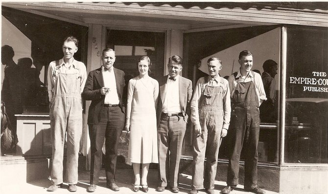 "Pictured is the Empire-Courier staff in front of the office on Yampa Avenue. From left are Lloyd DuePree, C. A. Stoddard, unknown woman, L.S. ""Ted"" McCandless, Carl Van Dorn, Ron Moore. The photo was taken circa 1932"