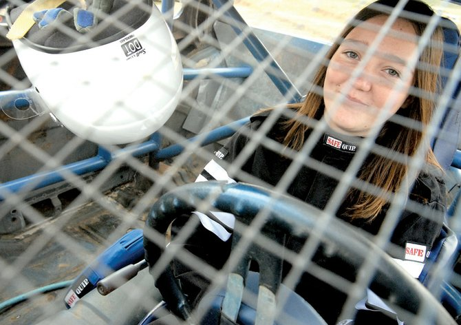 Izzy Hitz, 14, a rookie in the Sport Stock class prepares for her hot run Saturday at Hayden Speedway. Hitz currently is in second place in the rookie driver standings.