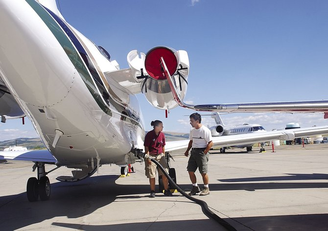 Charter pilot Benny McClelland of Western Airways observes Monday as Amber Whitlock of Spectrum Jet Center fuels his Cessna Citation VII. McClelland and colleague Mike Doerge were preparing for a departure today. Spectrum Jet Center could be replaced by Galaxy Aviation of Steamboat-Hayden, county officials said Monday.