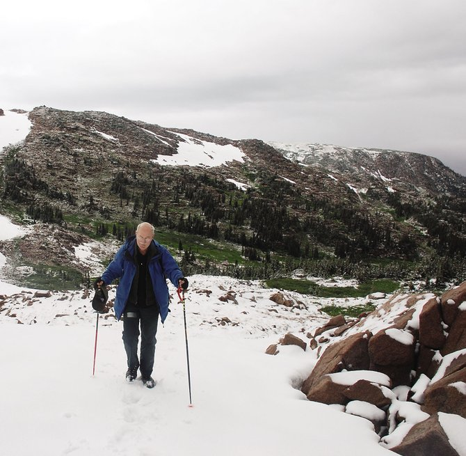Kirk Wolff, of Steamboat Springs, trudges across a mixture of fresh snow and last winter's drifts on the return trip to Slide Lake in the Mount Zirkel Wilderness Area on Saturday.
