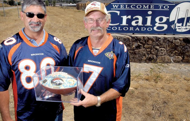 Tony Maneotis, left, and Craig Mayor Don Jones show their Broncos pride Tuesday. Jones and Maneotis helped Craig win the title of the Denver Broncos' biggest fans. Craig was chosen to host a celebration complete with Broncos cheerleaders, alumni and Super Bowl trophies.