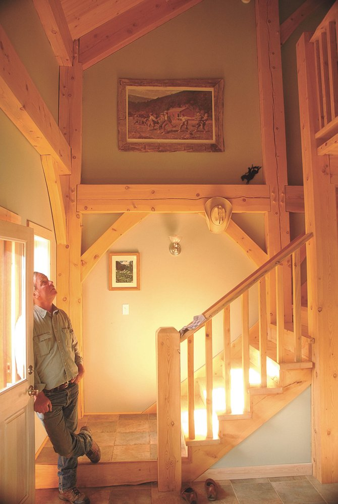 North Routt County resident Charlie Cammer looks up the stairs in his home, which he built at his wife's request using beetle-killed, blue-stain lodgepole pine.