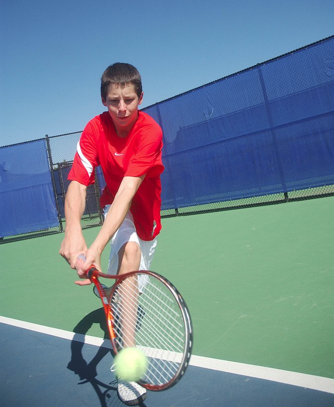 Steamboat Springs High School freshman Jamey Swiggart practices Tuesday at the Tennis Center at Steamboat Springs.