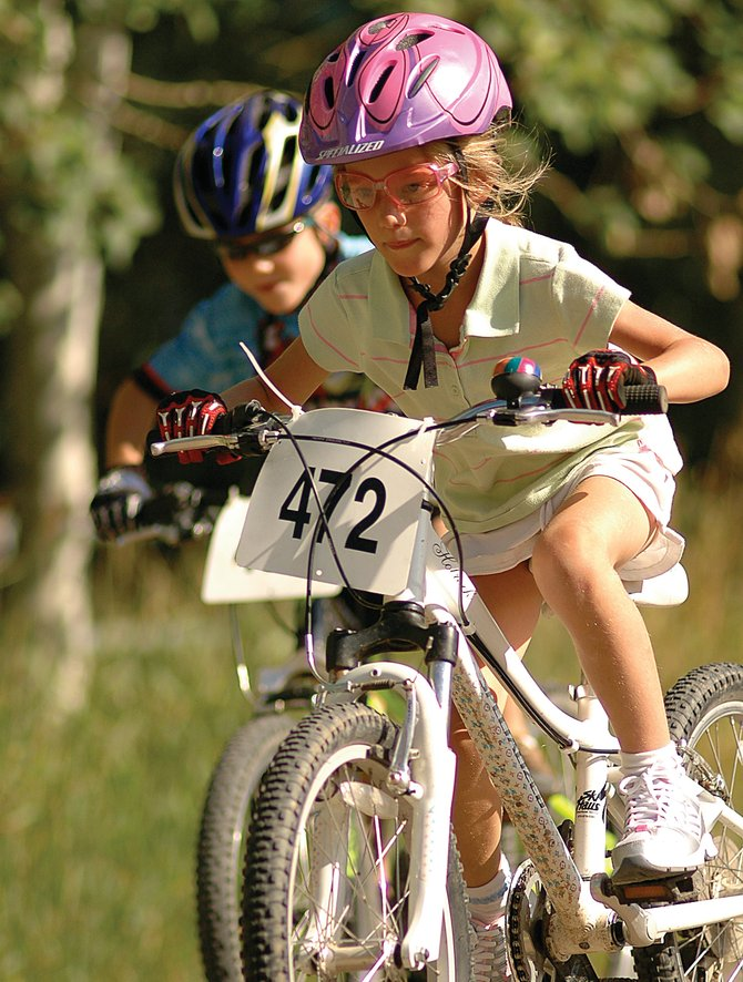 Isabella Boniface focuses on the course Wednesday evening at the Buffalo Pass Hill Climb bike race. Isabella, 7, has been racing in the Town Challenge children's events all summer. Her mother, Kelly Boniface, won the women's open division.