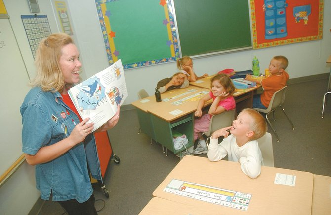 "South Routt Elementary School first-grade teacher Richel Eskridge reads her students the ""Don't Eat the Teacher"" children's book, by Nick Ward, on Thursday during the first day of school."