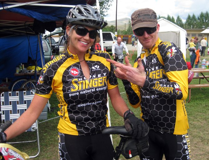 Kris Cannon, left, won the 24 Hours in the Sage mountain bike race in Gunnison last weekend. Nate Bird, right, worked her support tent during the race as Cannon built a five lap, 75-mile lead.