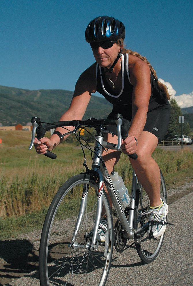 Kimberly Zacher rides Friday afternoon in Steamboat Springs to train for Sunday&#39;s Steamboat Springs Triathlon. The fourth annual triathlon will start at Lake Catamount at 8 a.m. More than 600 athletes are expected for the swimming, biking and running race.