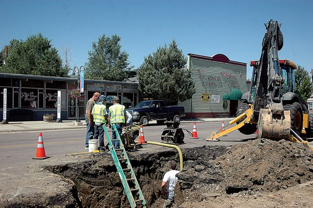 City of Craig employees pump water Sunday out of a hole excavated in the 400 block of Yampa Avenue in preparation to fix a leaking water line. The leak occurred around 7 p.m. Saturday night, said Tim Kulp, a water technician for the city of Craig's water department. The water line was shut down in the 300 and 400 blocks of Yampa Avenue while crews patched the golf ball-sized hole in the water line.