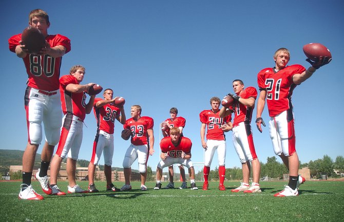 Quarterback Austin Hinder, back, center, will have plenty of weapons to use this year. Pictured, from left, are Steamboat Springs High School players Nelson Brassell, Alex Wood, Eric Bonner, Fraser Egan, Carl Steele, Joe Dover, Cody Harris and Jasper Gantick.