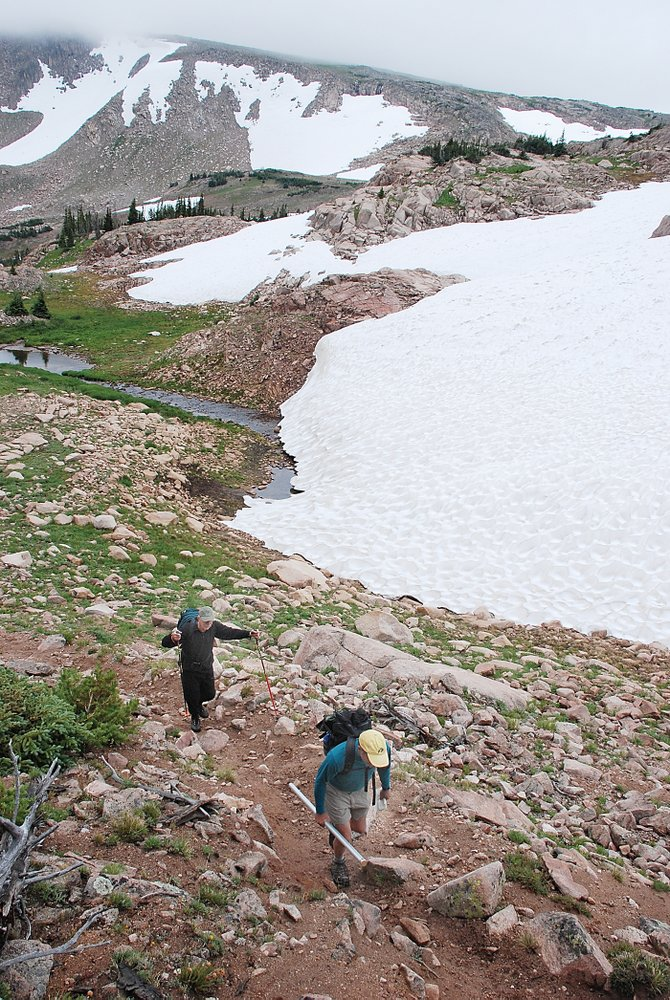 Jim Comeau and Kirk Wolff trek the Continental Divide under a low cloud ceiling.