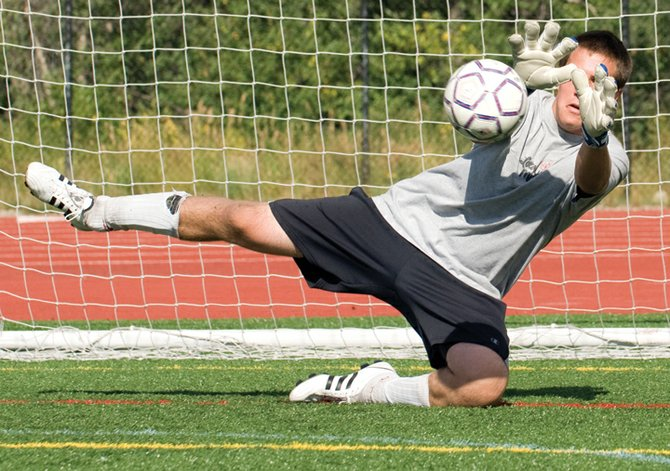 Goalkeeper Connor Birch stops a hard shot during Monday afternoon's practice at Gardner Field. Birch will be one of several veteran players the Sailors will be looking to for leadership this season.