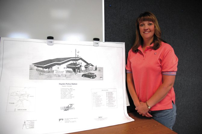 Bonnie Carrico, standing next to plans for the new Hayden Police Station on Friday, will leave her position as deputy town clerk to serve as police clerk.