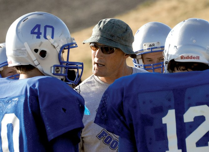 Moffat County High School defensive coordinator Lance Scranton addresses his unit during the Bulldogs' four-team scrimmage Friday. Moffat County competes at No. 1 state-ranked Berthoud on Friday.