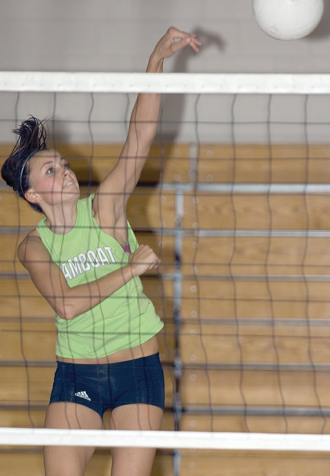 Steamboat Springs junior Colleen King rockets a shot over the net during volleyball practice Tuesday afternoon inside the high school gym. King, along with other veteran players such as Kasey Bull and Maggie Kriz, are expected to lead the charge for the Sailors this year on the court.