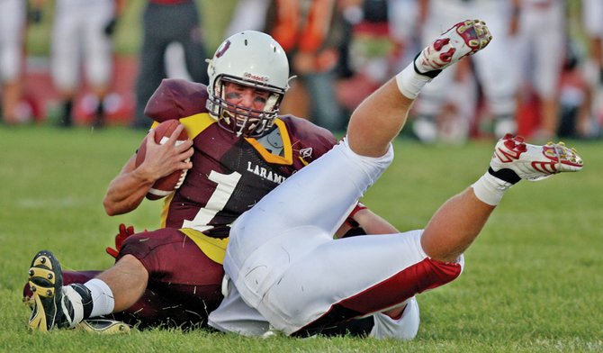 Steamboat Springs junior Egan Fraser goes head over heels dropping Laramie quarterback Coleton Wilson in the backfield.
