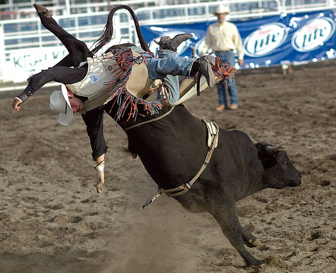 Matt Dunsmore soars from the back of Crazy Legs on Sunday at the Rocky Mountain Bull Bash Professional Bull Riding event in Steamboat Springs.