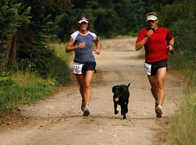 Lynn and Andy Picking run with their dog, Lola, on Sunday in the 10K at 10,000.