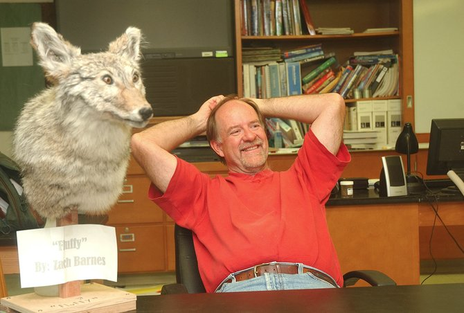 Hayden High School science teacher Dean Massey talks Tuesday while sitting next to Fluffy, a taxidermy project completed last year by one of his students.