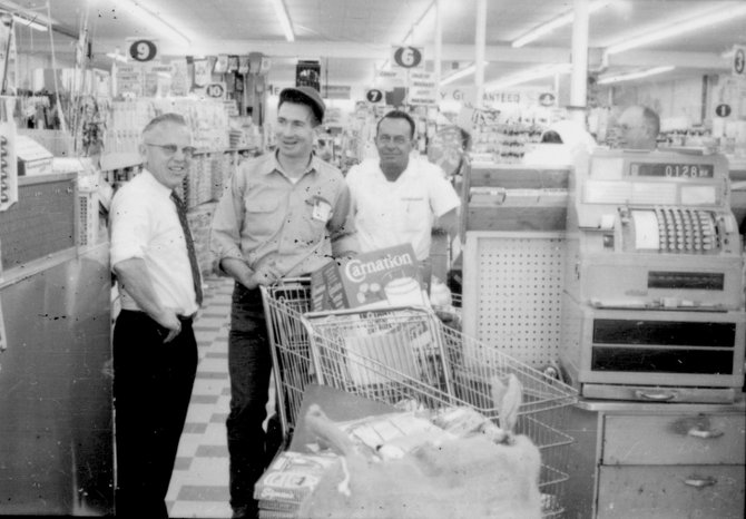 Bob Trevenen, center, is pictured with the groceries he won in a Pepsi-Cola contest at Bill's Market in 1964. Shown with Bob on the left is Bill Bilsing, owner of Bill's Market, and Bernie Beuscher, vice president of the Pepsi-Cola Bottling Co. in Grand Junction.