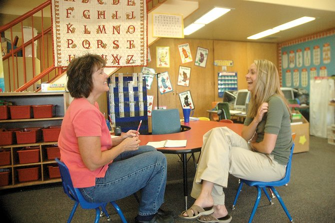 Kathy Duran, left, and Sara Linsacum take a break together after school Friday in Duran's room at Sunset Elementary School. Duran, who has been a teacher for 25 years, is mentoring Linsacum, a first-year teacher.
