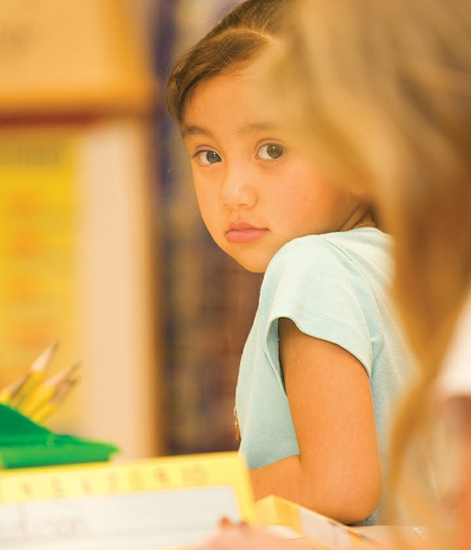 Kindergartner Luz Tarango listens to her teacher during art class Thursday at Strawberry Park Elementary School. The Steamboat Springs School District is seeing a growth of only six students this year.
