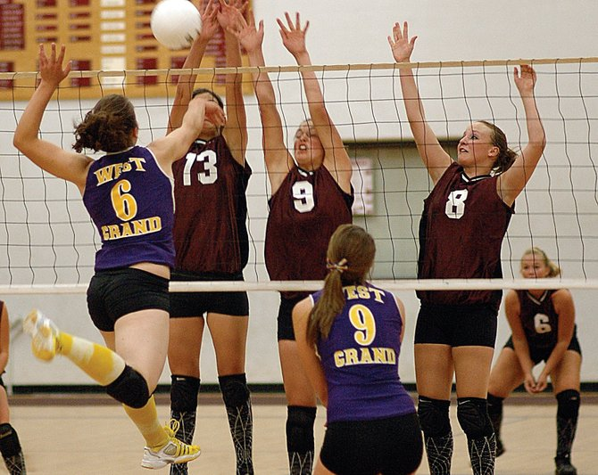 West Grand senior Renea Ellison, No. 6, tries to squeeze a ball past Soroco's Ceanna Rossi, No. 13, Sarajane Rossi, No. 9, and Corey Snyder, No. 8. Soroco lost to the Mustangs on Thursday night, falling in three games.