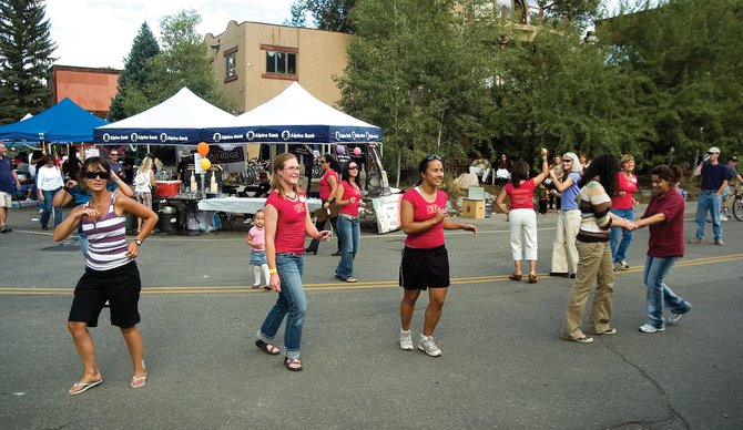 Participants learn to salsa at the fourth annual Festival of the Americas in downtown Steamboat Springs on Sept. 15, 2007.
