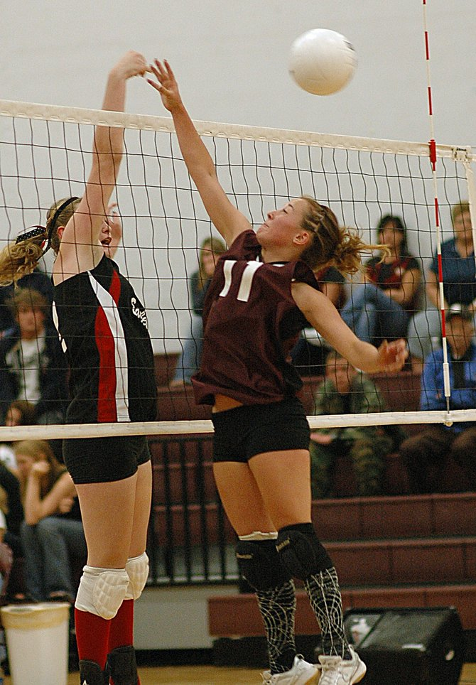 Tatum Lombardi tries to tip a ball back to the Paonia side of the net Saturday as the Rams played the Eagles. Soroco lost the match despite winning the first game. The Rams are now 0-2 on the season.