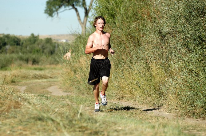 MCHS senior runner Colt Criswell competes in the Bulldog time trials two weeks ago at Loudy-Simpson Park. Criswell helped pace the Moffat County boys team Saturday in Grand Junction by finishing seventh overall.