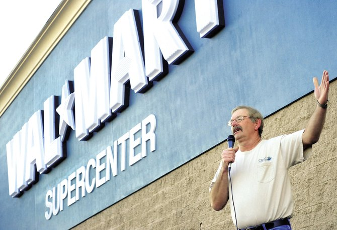 Craig Mayor Don Jones celebrates the grand opening of the city's Wal-Mart Supercenter this spring. Steamboat Springs city officials are again discussing the possibility of a big box retail store in west Steamboat as a means of curbing sales tax leakage.
