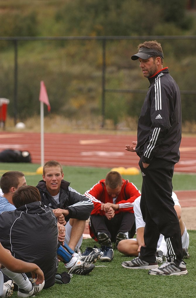 Steamboat Springs High School boys soccer coach Rob Bohlmann talks to his players after Tuesday's game. The Sailors beat the Moffat County Bulldogs, 6-0, with help from a hat trick from junior Tony Rende.