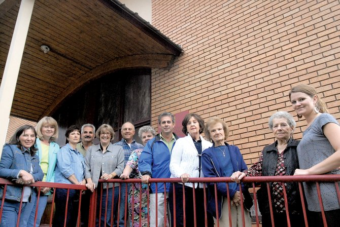 Saint John the Baptist Greek Orthodox Church is celebrating its 50th anniversary this weekend. Members of the church pictured, from left, are Ann Papoulas, Ann Charchalis, Robin Knoche, Nick Charchalis, Marianna Raftopoulos, John Raftopoulos, Jeannie Glimidakis, Steve Maneotis, Mary Ruth Papoulas, Kate Peroulis, Dimitra Charchalis and Audrey Anna Charchalis.