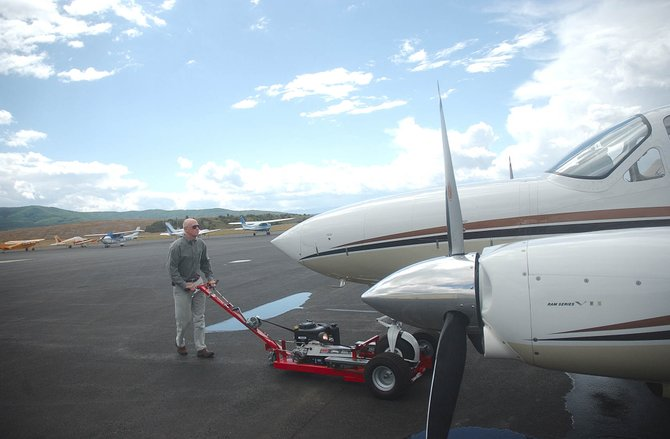 Steamboat Springs pilot Eric Smith pushes a plane into his hangar Wednesday at the Steamboat Springs Airport.