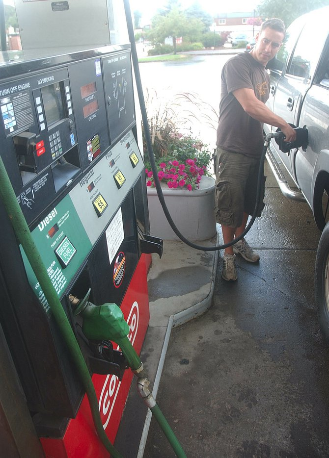 Matt Blue, of Denver, fills up his truck Thursday at Bob's Downtown Conoco in Steamboat Springs. Some residents have questioned why local gas prices haven't decreased as dramatically as gas prices in other cities and states.