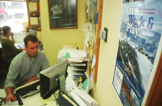 A poster near the desk of Steamboat Ski and Resort Corp. human resources recruiter Jim Kosky advertises employment opportunities with the ski area. Ski Corp. has had to find creative solutions to attract seasonal workers in light of caps to federal H-2B visas.