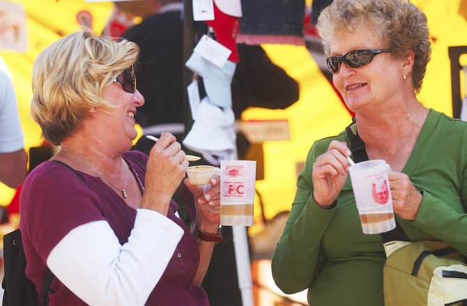 Steamboat Springs resident Nancy Working, right, enjoys chili and beer Saturday with her sister Cindy Jeruss, who was visiting from California. The two were attending the South Meets Old West Festival at 12th and Yampa streets.