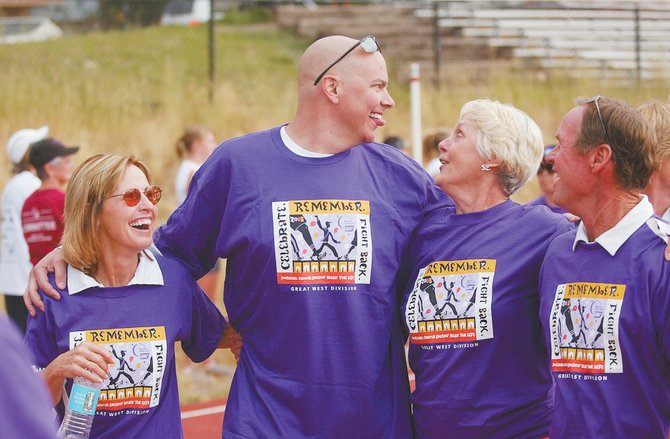 Cancer survivors, from left, Sandy Jenny, Jason Sear, Bev Engel and Keith Leifer participate in the Survivor Walk during the Steamboat Springs American Cancer Society Relay For Life in August at Steamboat Springs High School.