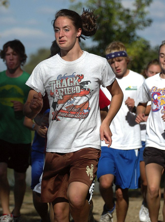 Moffat County High School senior Alicia Nelson leads the Bulldog cross-country team through warm-ups Monday at Loudy-Simpson Park. Nelson earned a second-place finish Friday in the Liberty Invite, her fourth top-3 finish in as many meets.