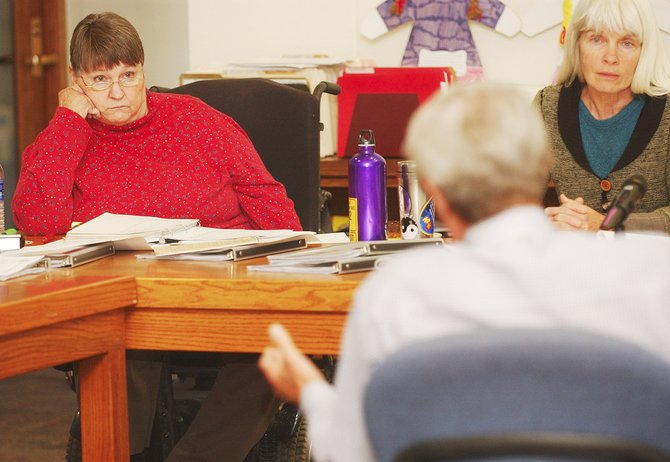 Routt County Commissioners Nancy Stahoviak, left, and Diane Mitsch Bush listen to Sheriff Gary Wall speak during a budget discussion Tuesday in the Commissioners Hearing Room.