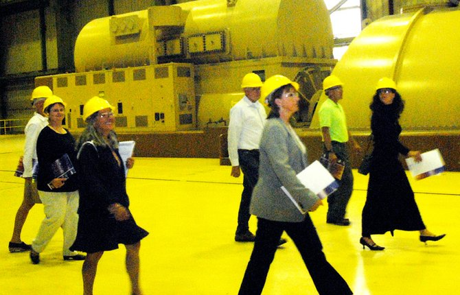 Members of the Craig/Moffat Economic Development Partnership and Colorado Office of Economic Development and International Trade team walk by one of three electric generation turbines at the TriState Craig Station power plant Thursday.