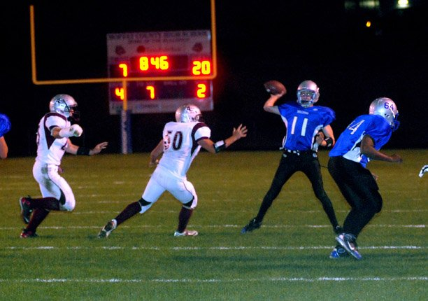 Moffat County quarterback Matt Linsacum gets off a fourth-down pass amid Palisade pressure Friday night.