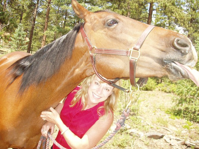 Christina Haxton poses with her horse, Jack. Haxton, who recently moved to Steamboat Springs, uses horses to teach professionals how to improve their work relationships.
